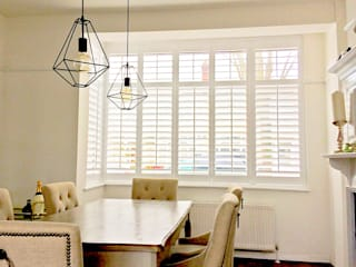 Full Height Shutters in the Dining Room:  Dining room by Plantation Shutters Ltd