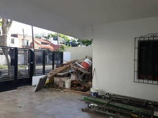 Remodelación de Casa en Florida, Buenos Aires: Garajes de estilo  por Laura Avila Arquitecta - Ciudad de Buenos Aires,Moderno
