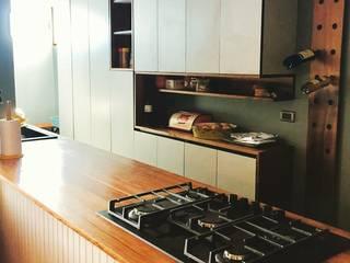 Modern kitchen by MMAD studio - arquitectura interiorismo & mobiliario - Modern