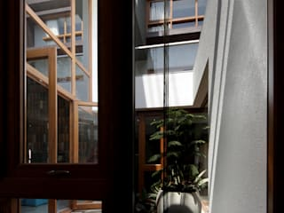 Cube House:  Wooden windows by Reasoning Instincts Architecture Studio