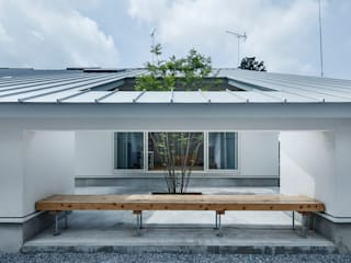 吉田裕一建築設計事務所 Jardines de estilo minimalista