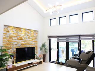남유럽풍 전원주택: (주)디엘건축의  거실,컨트리