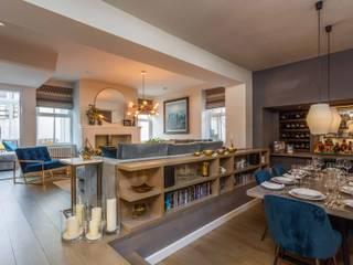 Sunken Bar and Living Room in Basement Modern dining room by Pfeiffer Design Ltd Modern