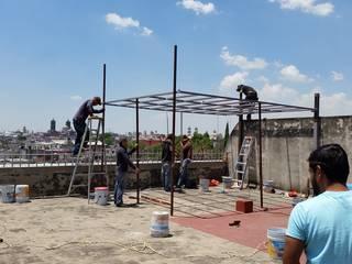realizacion de terraza con materiales reciclados de arkiteck Rural