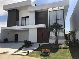 Fachada Moderna: Casas  por Andréa Generoso - Arquitetura e Construção