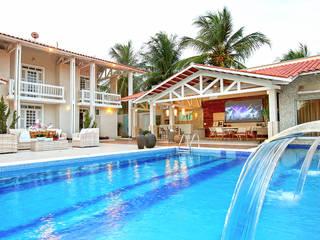 Residência em Fortaleza: Piscinas de jardim  por RI Arquitetura