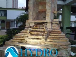 CORTINAS MUROS Y PAREDES DE AGUA: Edificios de oficinas de estilo  por HYDRO FUENTES Y CASCADAS