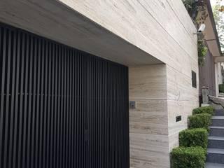 Bosque de olivos: Casas de estilo moderno por Caltec