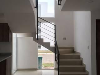 Jaspe: Escaleras de estilo  por Integra Arquitectos