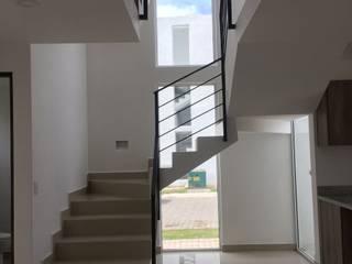 Onix: Escaleras de estilo  por Integra Arquitectos