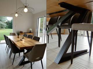 Dining room by UN AMOUR DE MAISON, Modern