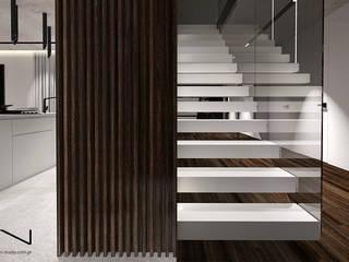 Projekt wnętrza nowoczesnego domu, Wrocław: styl , w kategorii Schody zaprojektowany przez IN studio projektowania wnętrz