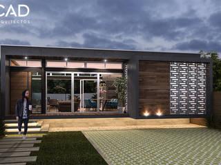 Fachada: Casas unifamiliares de estilo  por CAD Arquitectos