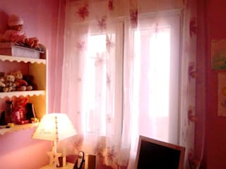 Espacio para el estudio de estilo romántico:  de estilo  de CONSUELO TORRES