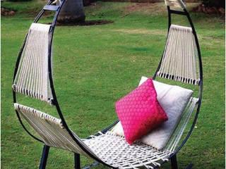 Mecedora Circular:  de estilo  por DINNOVA muebles