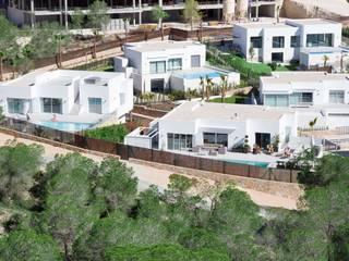 Residencial Naranjo Casas de estilo moderno de 2J Arquitectura Moderno