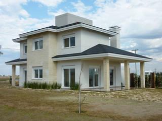 Casa na Praia - Xangri-lá: Casas familiares  por Mosaico Arquitetura,Moderno
