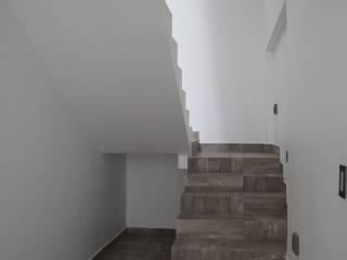 ESCALERAS : Escaleras de estilo  por ARQUITECTOS TREJO