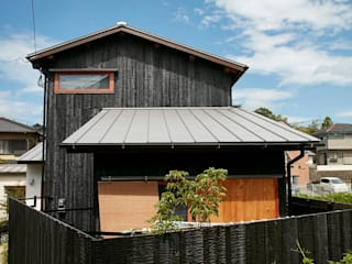 Rustic style house by でんホーム株式会社 Rustic