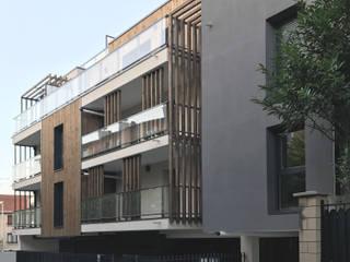 Edifício de apartamentos Georges Gay por OGGOstudioarchitects, unipessoal lda Moderno