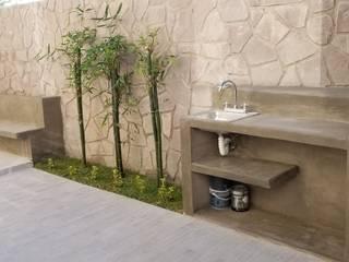 banca y jardinera: Terrazas de estilo  por Artiphise
