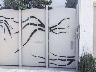 celocia: Puertas principales de estilo  por Artiphise