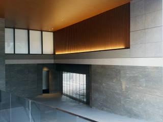 エラモサ大理石壁のある住まい: JWA,Jun Watanabe & Associatesが手掛けた家です。