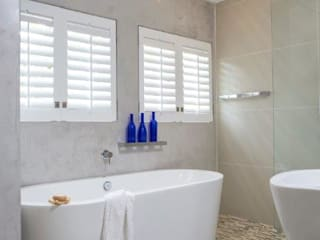 Remodeling of the face brick home Deborah Garth Interior Design International (Pty)Ltd Modern bathroom
