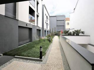 Apartamentos Mares por OGGOstudioarchitects, unipessoal lda Minimalista