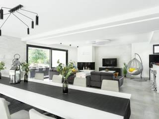 Dom w Pszczynie: styl , w kategorii Salon zaprojektowany przez FAJNY PROJEKT