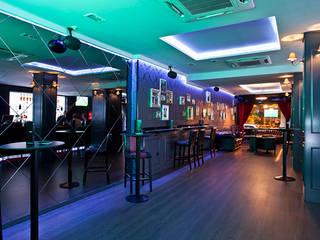 Diseño y decoración de un bar musical en Madrid: Bares y Clubs de estilo  de Muka Design Lab