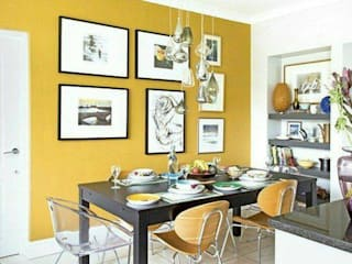 Dining room with Yellow walls and complementing chairs:  Dining room by AK INTERIOR ARCHITECTS
