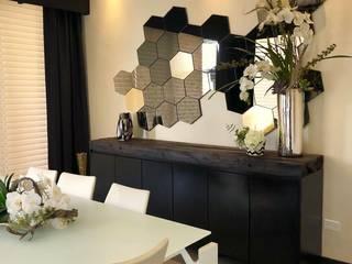 Dining room by Athalia cocinas y Carpinteria