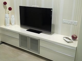 TV set and storage below:   by Chawla N Associates