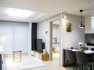 부산 모델하우스 세팅, 편안하면서 세련된 모던스타일 - 노마드디자인: 노마드디자인 / Nomad design의  거실