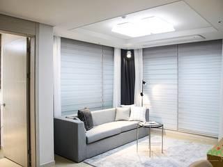 Living room by 노마드디자인 / Nomad design