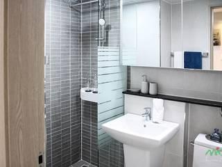 부산 모델하우스 세팅, 편안하면서 세련된 모던스타일 - 노마드디자인: 노마드디자인 / Nomad design의  욕실