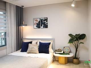부산 모델하우스 세팅, 편안하면서 세련된 모던스타일 - 노마드디자인: 노마드디자인 / Nomad design의  침실
