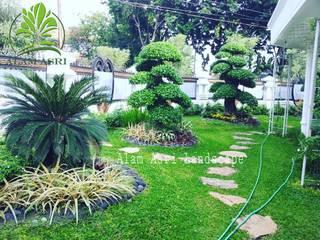 Alam Asri Landscape Jardines en la fachada Madera Verde