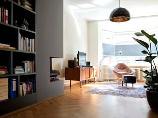 Kleurrijke familiewoning Den Haag: moderne Woonkamer door Atelier Perspective Interieurarchitectuur