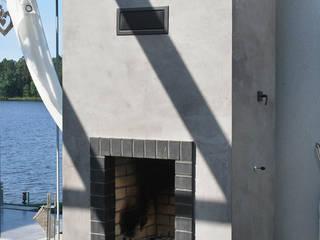 Efekt betonu w domu jednorodzinnym Minimalistyczny salon od Rawtype Minimalistyczny