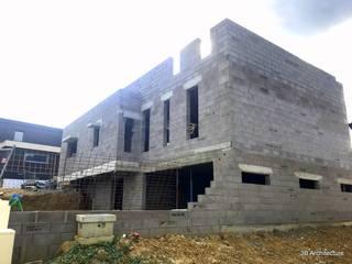 Maison M05: Maisons de style  par 3B Architecture