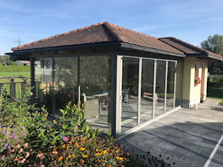 Jardin de style  par Schmidinger Wintergärten, Fenster & Verglasungen