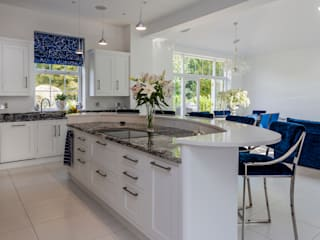 Stunning contemporary kitchen in Hertfordshire made and designed by John Ladbury and Company:   by John Ladbury and Company