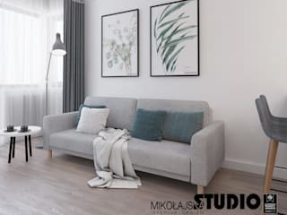 Living room by MIKOŁAJSKAstudio