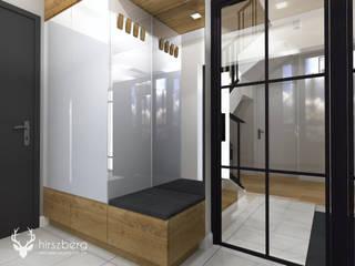 Modern corridor, hallway & stairs by ANNA HIRSZBERG 'HIRSZBERG' PRACOWNIA ARCHITEKTONICZNA Modern