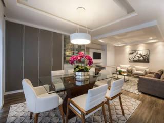 Residência C|J: Salas de jantar  por iLLUS Studio de Arquitetura