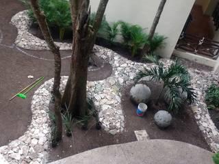 jardín del café del lobby: Jardines de piedra de estilo  por David Araiza Pérez DAP Diseño,  Arquitectura  y Paisaje