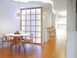 Espacio diáfano que integra comedor-cocina-estar: Comedores de estilo  de Loft 26
