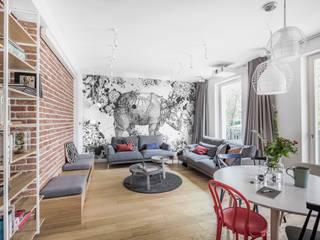 Apartament dwa poziomy: styl , w kategorii Salon zaprojektowany przez Complete Home